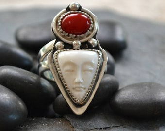 Sterling silver ring with carved moonface and coral cabochon.  size 7.75