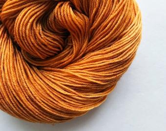 HONEYGOLD hand dyed yarn fingering sock dk bulky yarn super wash merino wool yarn single or ply. you choose your base. honey brown gold yarn