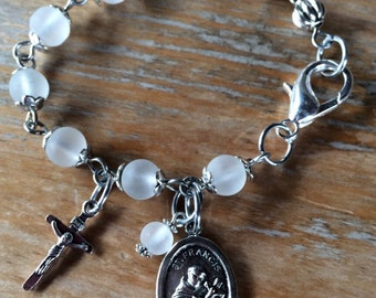 Prayer bracelet, handmade with white frosted glass beads, small crucifix with St Francis medallion charm