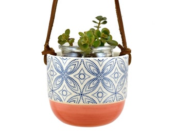 Planter is hung on a cactus - coral color - blue stars