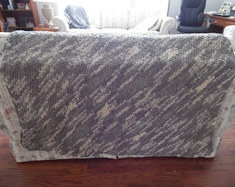 Gray and beige soft hand-knit blanket