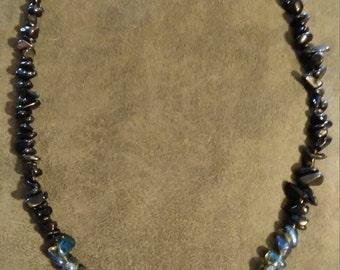 Blue sodalite pedant on labradorite, black obsidian, and titanium coated quartz necklace
