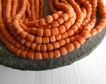 orange  glass seed bead, matte barrel tube, small rustic ethnic spacer , indonesian 3 to 6mm, new indo-pacific (22 inches)7ab29-9