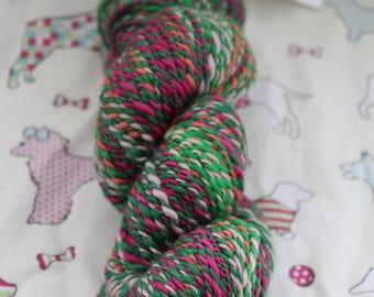 Hand spun, 100% wool, DK, pinks and greens