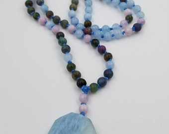 Kunzite, Ruby Apatite and Aquamarine Mala finished with a Faceted Aquamarine Guru Bead