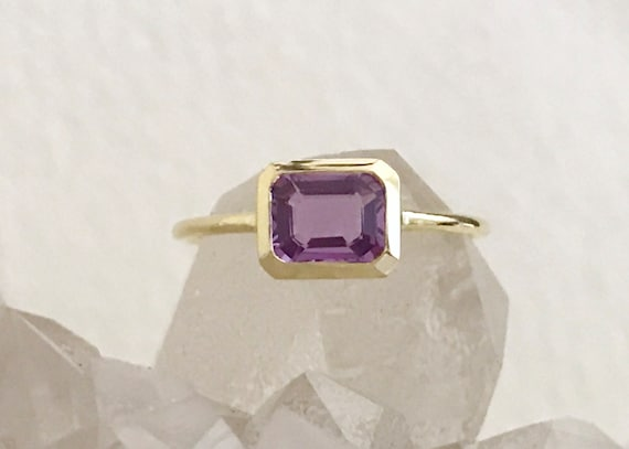 Untreated purple sapphire and solid 19k gold ring