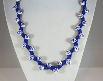 Blue and white painted bead crochet necklace