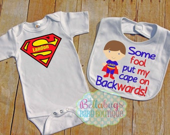 Super Hero Bodysuit and BIB - Some Fool put my cape on backwards- Boy Super Hero - Superman - Can choose hair color - Personalized