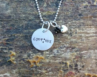 Cont;nue hand stamped pendant. Your choice of either Necklace or Keychain