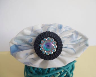 Oval fabric and blue rhinestone brooch