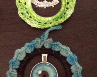 Crocheted  2  AnyTime Ornaments eyeball and flying saucer pendants  inventory clearance