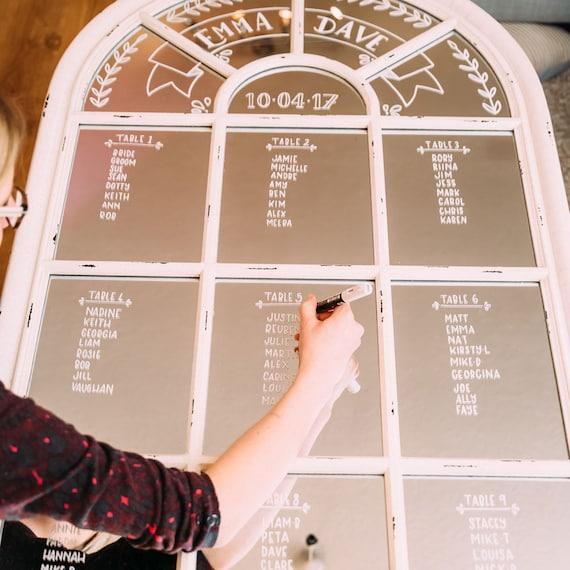 Custom Hand lettered mirror wedding table setting plan.