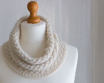 This cowl is The Daisy Cowl - a textured hand knit cowl in creamy undyed baby alpaca yarn