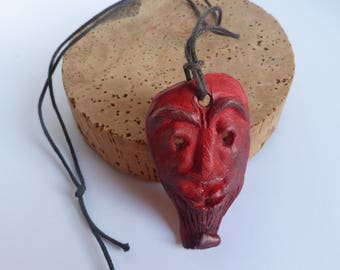 Small ceramic hanging, wax color red and black mask