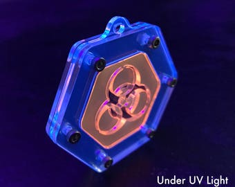 Hexagonal Biohazard Cybergoth Pendant in UV Reactive Orange & UV Reactive Blue