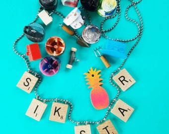 Custom scrabble board game letter necklaces and charms!