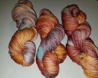 "Katie, a hand-dyed superwash merino wool/nylon blend sport weight yarn.  274yds/100gms/hank.  6sts=1"" on #3-5 needles."