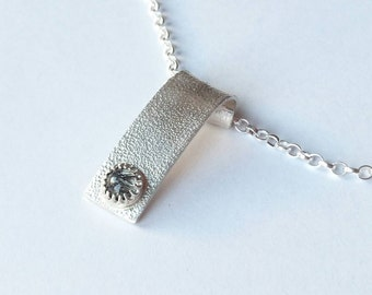 Sterling silver handmade textured necklace with 6m black rutilated quartz cabochon, hallmarked in Edinburgh