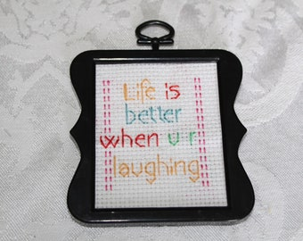 Finished cross stitch sign