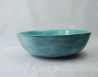 Mixed jades, turquoise and other blues serving bowl. Hand painted. Measures 13 1/2 by 5 inches tall  and slightly  octagon shape.