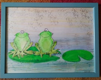 Frogs on lily pads.
