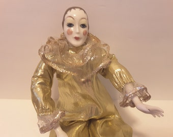 Harlequin doll in gold outfit with porcelin hands and feet
