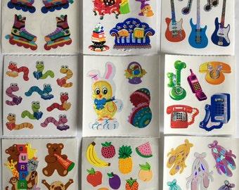 Vintage Sandylion Ballet, Guitar, Rollerblades, Party Bears , Fruit, Easter Bunny Stickers. 9 squares