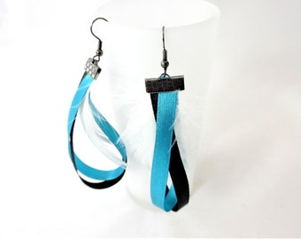 Earrings in black and turquoise ribbons and white feathers