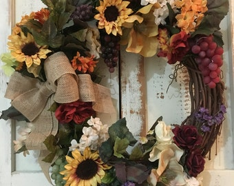 Floral wreath with burlap bow
