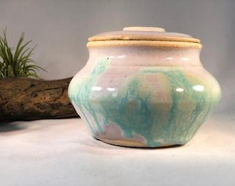 White Jar with green/blue glaze drips