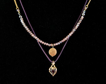 Double Strand Layered Necklace Set in Gold and Purple with Faceted Glass and Crystal Accents in Heart Shaped Cage Frame