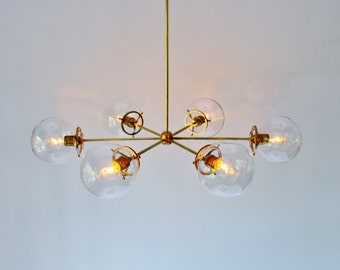 Brass Globe Chandelier, 6 Clear Glass Globe Shades, Large Modern Handmade Hanging Pendant Lighting Fixture by BootsNGus
