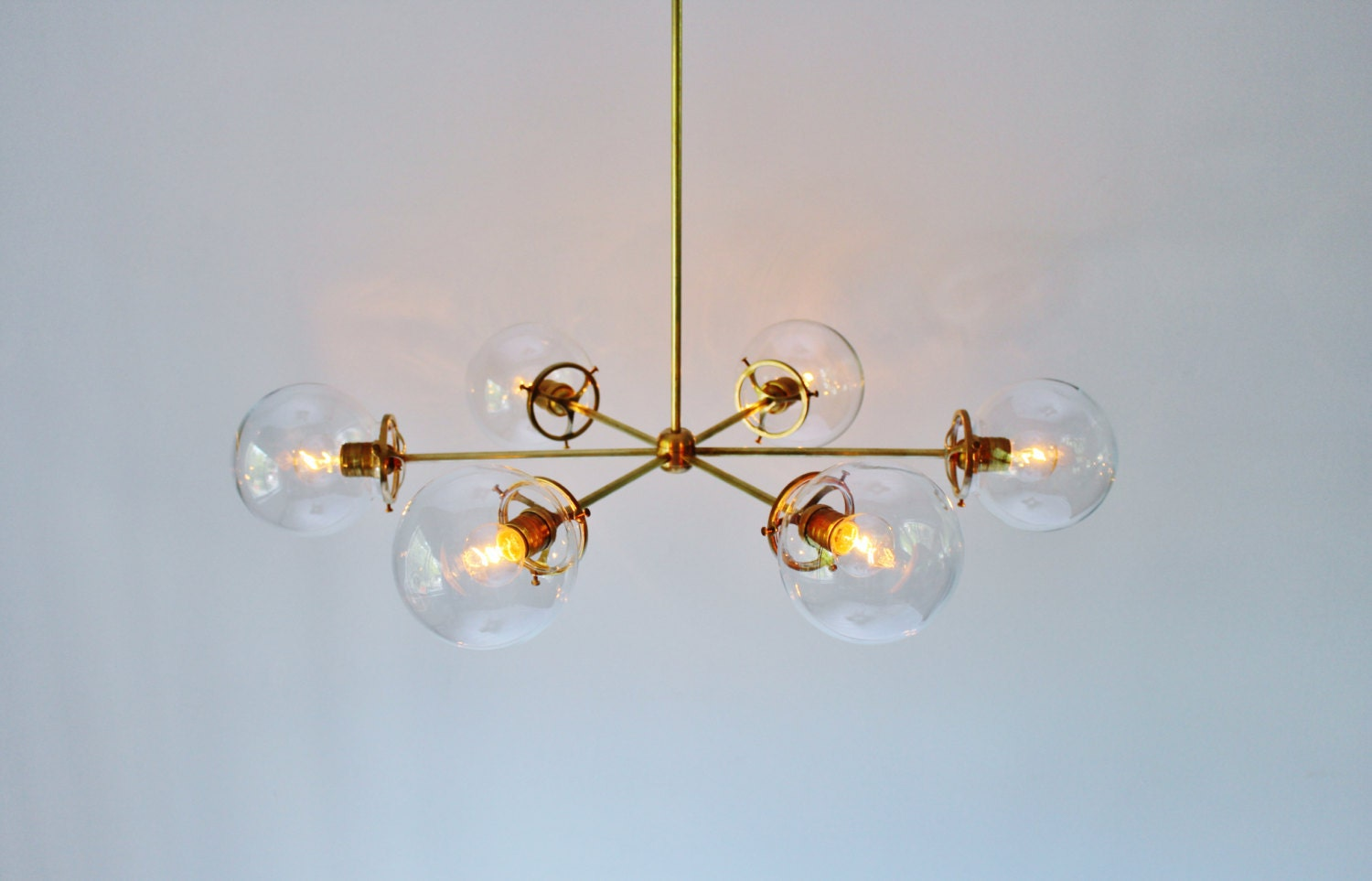 Brass globe chandelier 6 clear glass globe shades large zoom arubaitofo Image collections