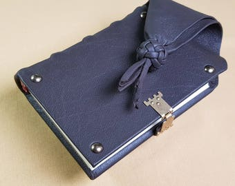 Girdle book-diary, 256 decorated pages, 15 cm x 11 cm.