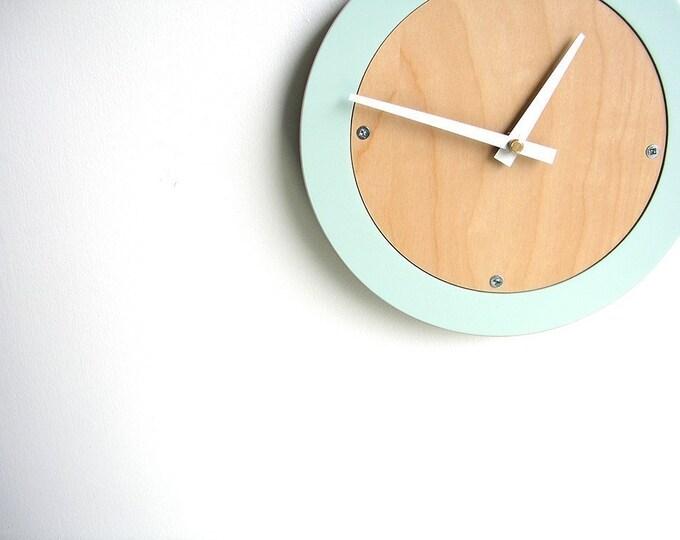 pale blue modern wall clock