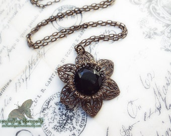 Nightshade ~ Victorian Noir filigree pendant necklace with Vintaj brass components, faceted jet black glass stone