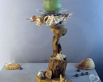 Decorative candlestick made of wood with ocean shells