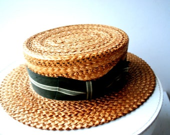 Antique  1880s , dak yellow, genuine straw, hand woven, boater hat with a swirl design on the top. Made by Kingsbury. Size 21.