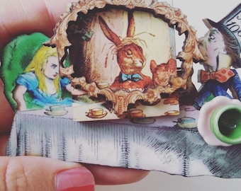 Feature Brooch, Alice in wonderland,tea party, mad hatter, white rabbit, tea cup, layered, framed, by NewellsJewels on etsy
