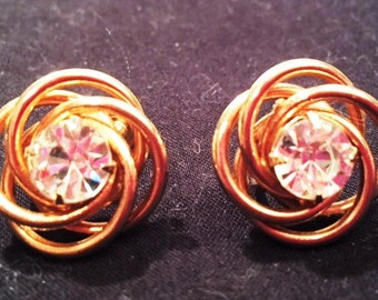 Earrings - Gold swirls with a rhinestone center, screw-back