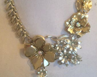 Necklace of vintage pieces repurposed.  Gold and silver color.