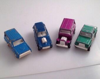 4  vintage tootsie toy cars