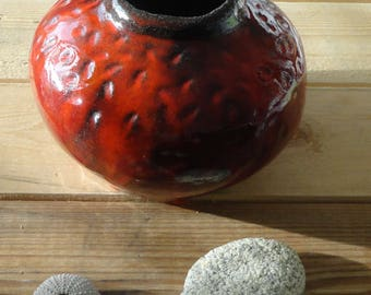 ceramic pot shaped by hand, flaming red enamel