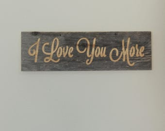 I Love You More (Reclaimed carved wood sign)