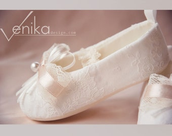 christening baby shoes in ivory with delicate pink