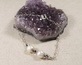 Bracelet freshwater white pearls and black swarovski crystal 925 sterling silver;  black and white bracelet with hearts made of 925 sterling silver chain.