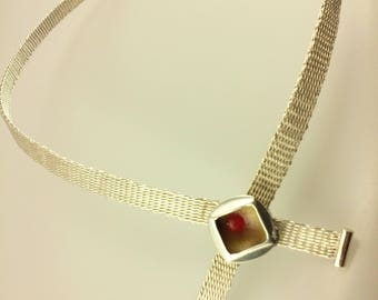 Woven fine silver necklace with enamel clasp