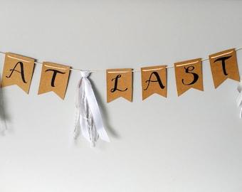 AT LAST- Kraft handlettered bunting banner with three tassels- handmade upcycled decor- shabby chic engagement wedding decor