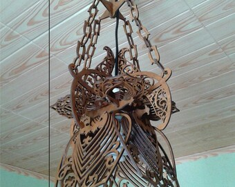 The original chandelier made of wood. Vector plan for manufacture on CNC