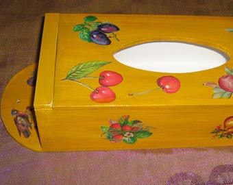 Hanging tissue box decorated in yellow with fruit carvings